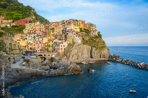 Fototapety, obrazy: Manarola - Village of Cinque Terre National Park at Coast of Italy. Beautiful colors at sunset. Province of La Spezia, Liguria, in the north of Italy - Travel destination and attractions in Europe.