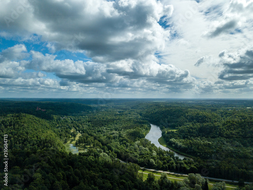 Poster Donkergrijs drone image. aerial view of rural area with dramatic clouds over river of Gauja in Sigulda district. Latvia