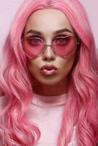 Fotografia  Beautiful young woman face close up