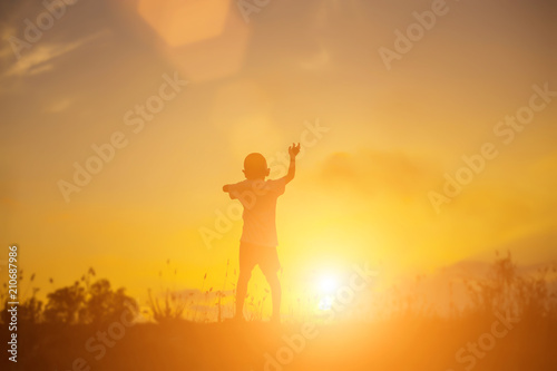 Fototapety, obrazy: kid silhouette,Moments of the child's joy. On the Nature sunset