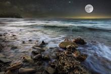 Sea Waves On The Stone Beach A...