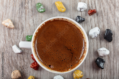 Wall Murals Chocolate Traditional Turkish Coffee cup concept with chocolates on wooden background.