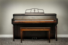 Old Vintage Piano In Home With Rich Wood Tones