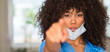 African american woman medical professional pointing with finger to the camera and to you, hand sign, positive and confident gesture from the front