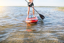 Man Rowing With Paddleboard On...