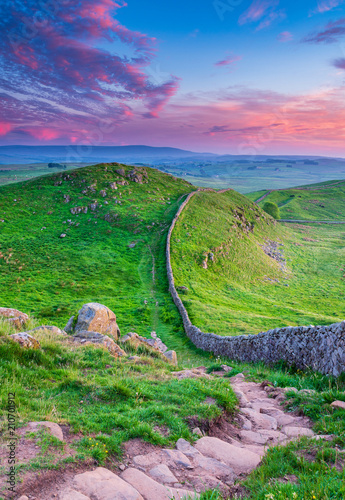 Spoed Fotobehang Groene Hadrian's Wall Portrait at Twilight / Hadrian's Wall is a World Heritage Site in the beautiful Northumberland National Park. Popular with walkers along the Hadrian's Wall Path and Pennine Way