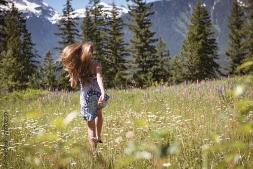 Girl having fun in field on a sunny day