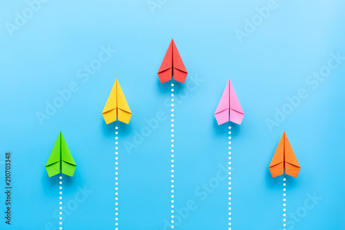 Photo  Paper plane on blue background, Business competition concept.