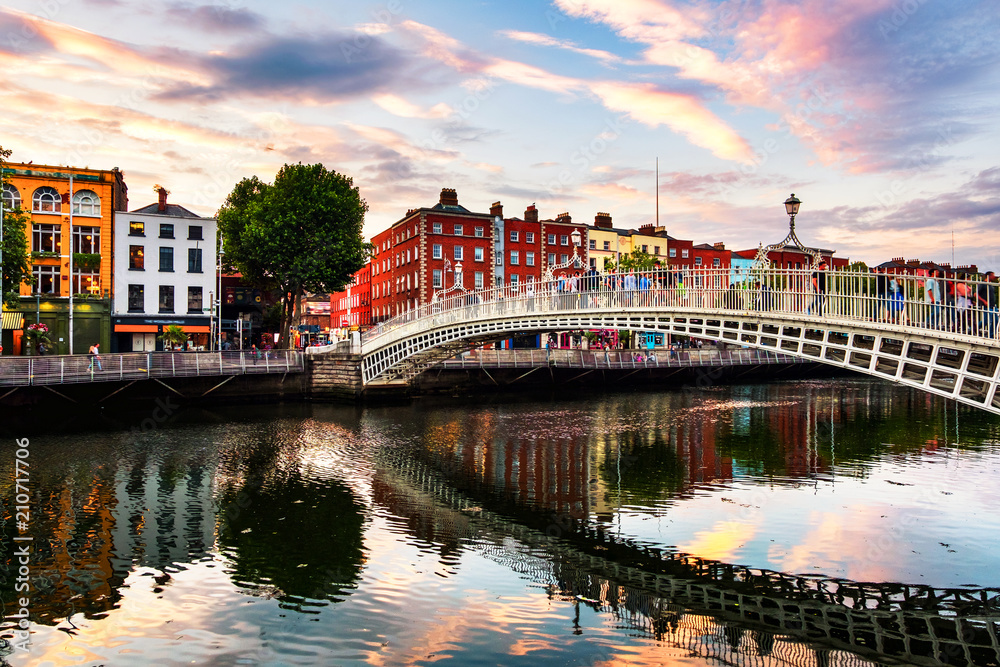 Fototapeta Night view of famous illuminated Ha Penny Bridge in Dublin, Ireland at sunset