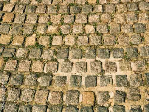 Foto op Canvas Stenen The texture of the urban paving stone