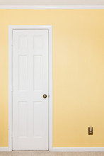 Clean White Door, White Trim, Yellow Wall