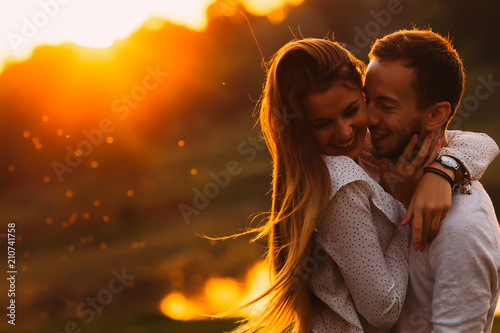 Fotografering passionate hug of a couple in love on the shore of an evening la