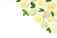 Styled Stock Photo. Summer Herbs And Fruit Composition. Lime, Lemon Slices And Fresh Green Mint Leaves Isolated On White Table Background. Juicy Food Pattern. Decorative Corner. Flat Lay, Top View.