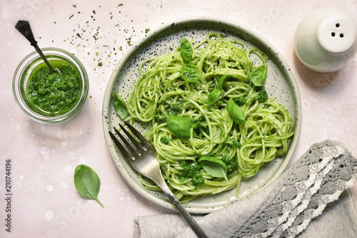 Spaghetti pasta with pesto sauce - traditional dish of italian cuisine.Top view.