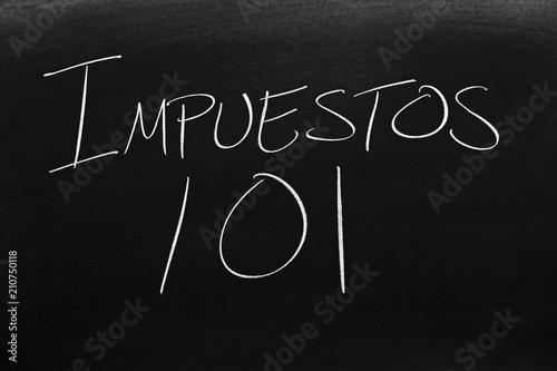 фотография  The words Impuestos 101 on a blackboard in chalk