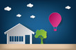 House vector illustration with cloud origami and hot balloon air. Paper art and craft style.