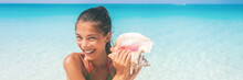 Beach Lifestyle Vacation Woman Blowing A Conch Playing Music On Caribbean Holidays. Asian Tourist Girl Smiling Having Fun Banner Panorama Header Crop.
