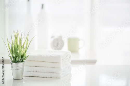 Fotografie, Obraz  Towels on white table with copy space on blurred bathroom background