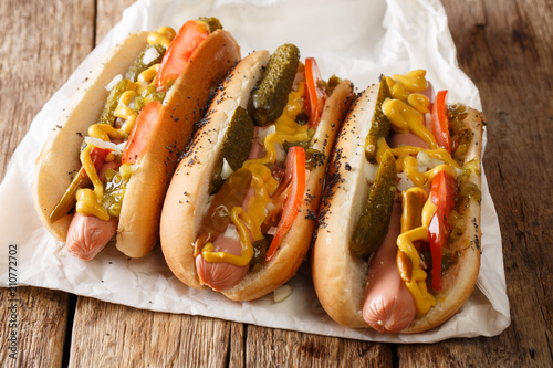 Delicious Chicago style hot dog with mustard, vegetables and relish close-up. horizontal
