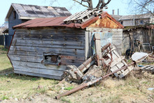 The Ruined Wooden Shed Is Located On The Country Backyard