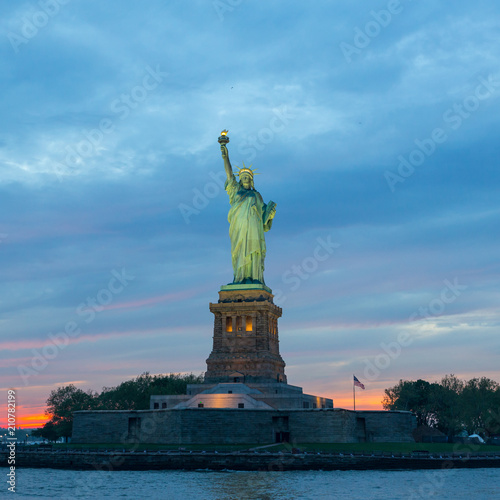 Staande foto New York City Statue of Liberty at dusk, New York City, USA.