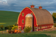 Red Barn And Orange Truck In P...