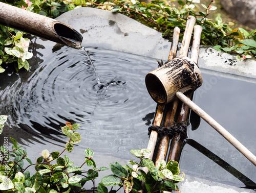 Foto op Plexiglas Japan Decorative stone water basin in traditional Japanese garden