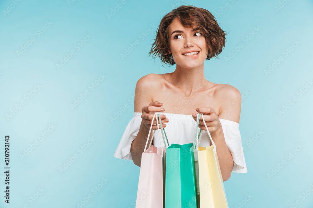 Fototapety, obrazy: Portrait of a smiling pensive woman holding shopping bags