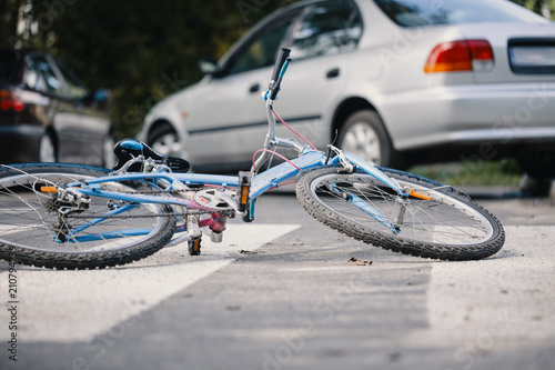 kid s bike on a pedestrian lines after danger incident with a car