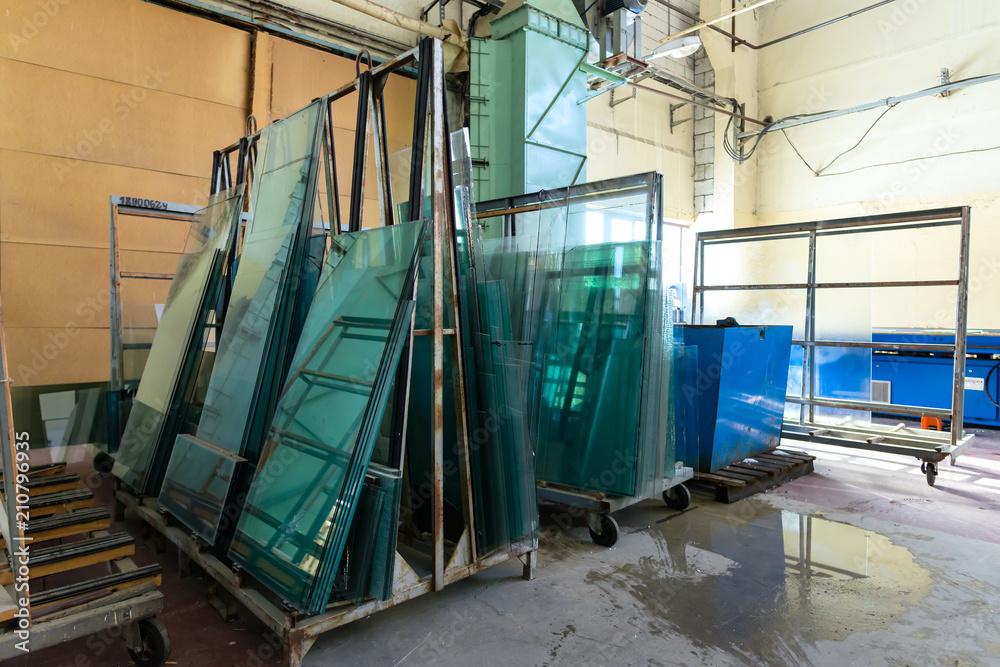 Fototapeta Glasses in industrial glass processing workshop