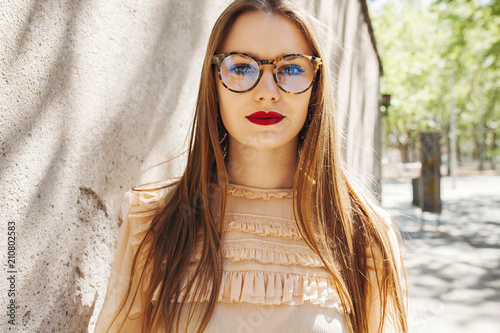 Young beautiful woman in glasses outside