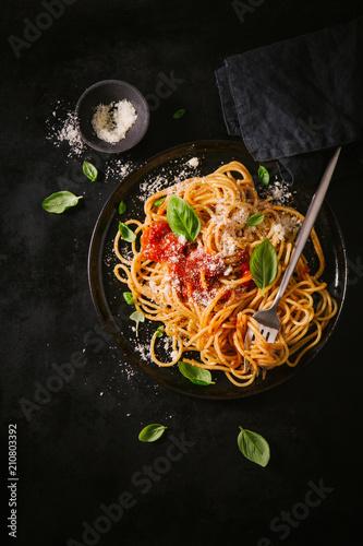 Dark plate with italian spaghetti on dark Wallpaper Mural