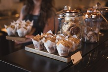 Close Up Of Muffins And Cookies At Counter