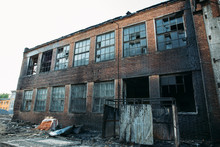 Exterior Of Burnt By Fire Brick Building, Burned Walls, Disaster Concept