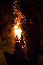 Children Watching A Bonfire