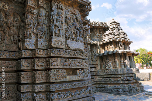 Fa ade and ornate wall panel relief of the west side, Hoysaleshwara temple, Hale Canvas Print