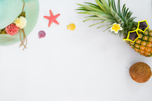 Hipster Pineapple Fashion With Tropical Fruit, Straw Hat, Sea Shells And Starfish. Summer Vacation Background Concept. Top View, Flat Lay