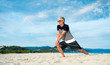 Senior man doing stretching exercises on the beach