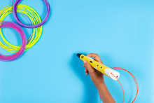 Child Draws With 3d Pen. Kid Holding 3d Pen With Plastic Filament