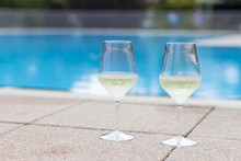 Drinking White Wine By The Pool