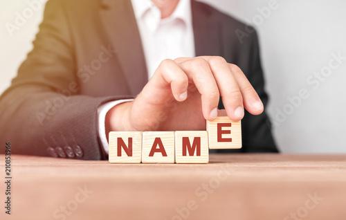 Cuadros en Lienzo Man made word NAME with wood blocks