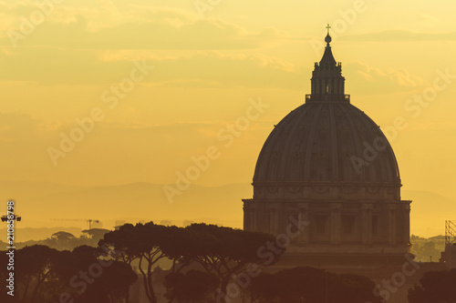 Fotografía St Peter's basilica dome at sunrise in Rome, Italy