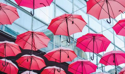 Umbrellas hanging between two buildings