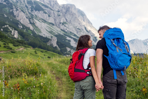 Foto op Aluminium Ontspanning Beautiful hiking couple enjoying in nature.Couple sharing love while walking in nature