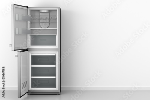 modern open empty fridge in front of white wall