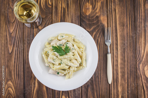 Photo dinner - Italian pasta and white wine, on a wooden background