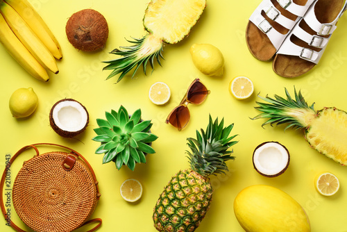 Stylish rattan bag, coconut, birkenstocks, succulent, sunglasses and yellow f...