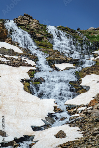 Fotografie, Obraz  Waterfall with ice and snowfields