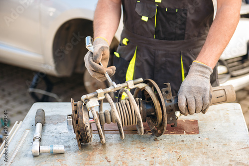 Photo Car suspension repair. Shock absorber.