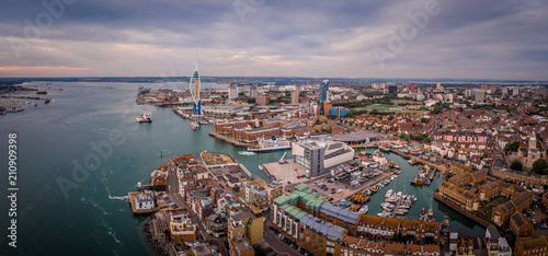 Photo Stands Ship Aerial view of Portsmouth in the evening, UK